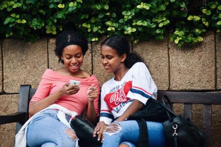 teen girls on a bench